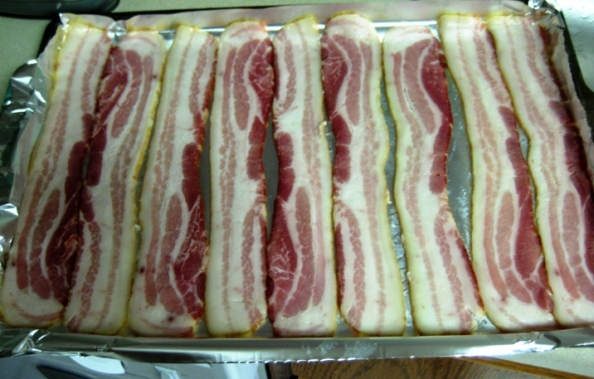 Raw bacon ready to go under the broiler. The foil is folded up at the edges to catch grease and help with clean up.